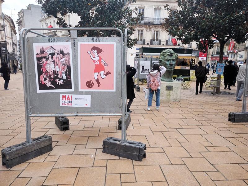 Das Stadtbild im Zeichen der Comickultur mit Postern von Ulli Lust und Anna Sommer und einer Bronzebüste des Zeichners Hergé